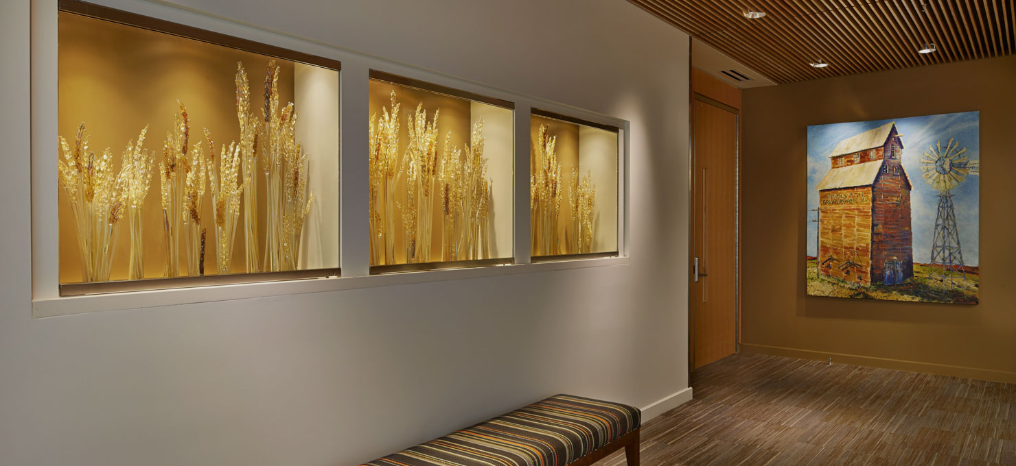 photo of the hospital interior hallway with beautiful artwork on the walls