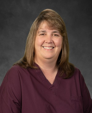 Profile photo of Family birth center manager, Tracy Wart, wearing maroon scrubs